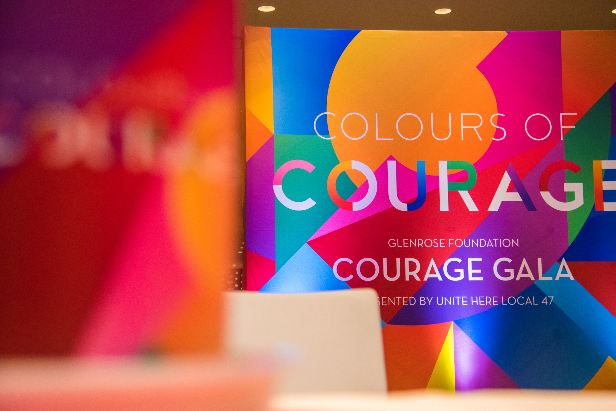 Brghtly coloured sign that says Courage Gala