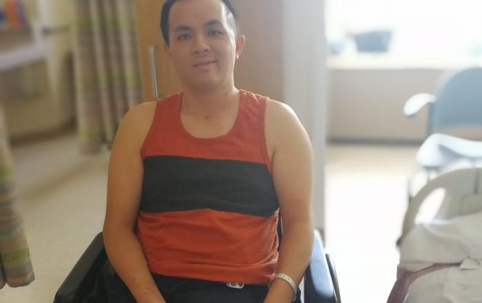 Man in a wheelchair inside a hospital room