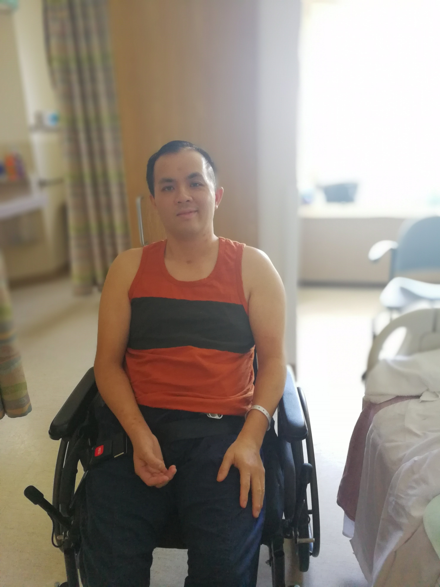 Man in a wheelchair inside a hospital room